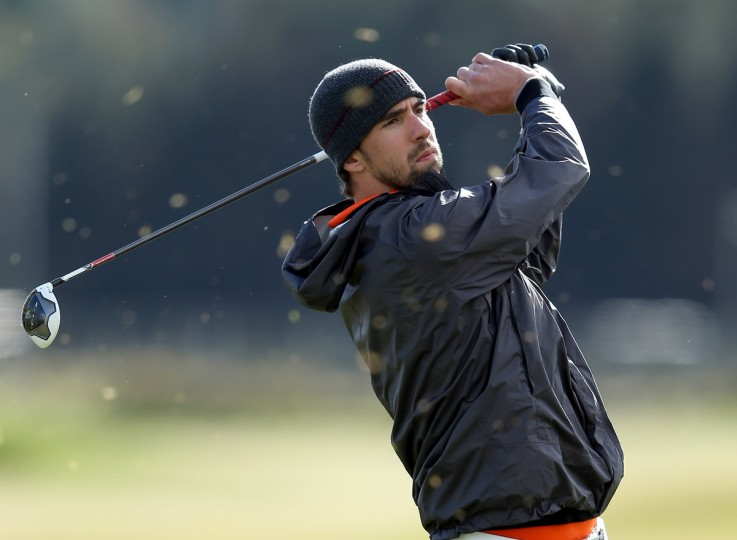 Olympic swimmer Michael Phelps of the USA in action during the practice round of The Alfred Dunhill Links Championship at The Old Course in St Andrews, Scotland. (Richard Heathcote/Getty Images)