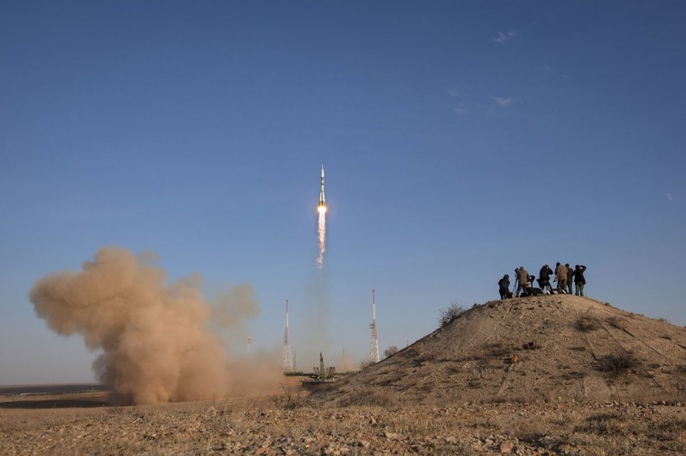 October 23, 2012: In this handout image provided by NASA, members of the media photograph the Soyuz rocket as it launches with Expedition 33/34 crew members Soyuz Commander Oleg Novitskiy, Flight Engineer Kevin Ford of NASA, and Flight Engineer Evgeny Tarelkin of ROSCOSMOS to the International Space Station in Baikonur, Kazakhstan. (Bill Ingalls/NASA via Getty Images)