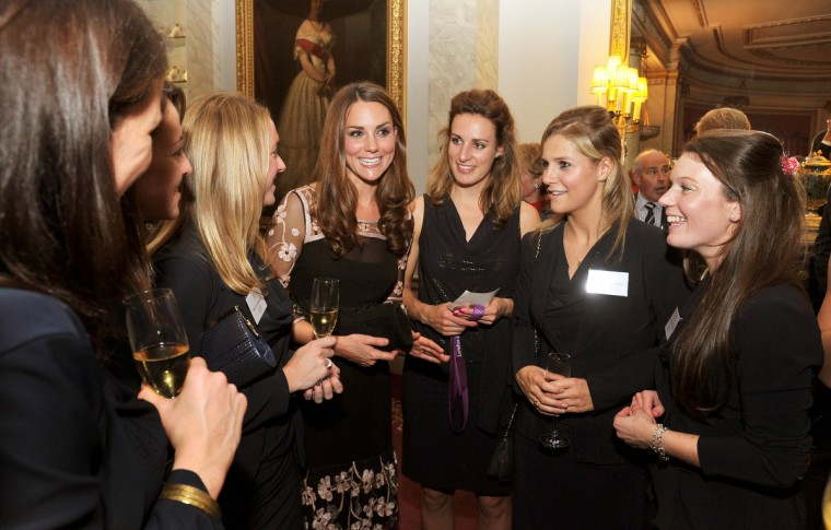 Catherine, Duchess of Cambridge (C) talks the Women's hockey team during a reception held for Team GB Olympic and Paralympic London 2012 medalists at Buckingham Palace in London, England. (John Stillwell/WPA Pool/Getty Images)