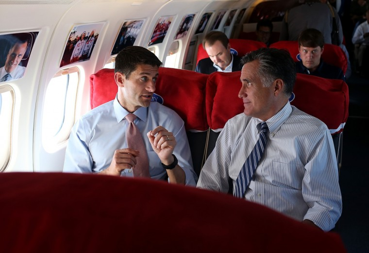 Republican presidential candidate, former Massachusetts Gov. Mitt Romney (R) talks with his running mate Rep. Paul Ryan (R-WI) (L) aboard the campaign plane en route to Denver, Colorado. (Justin Sullivan/Getty Images)