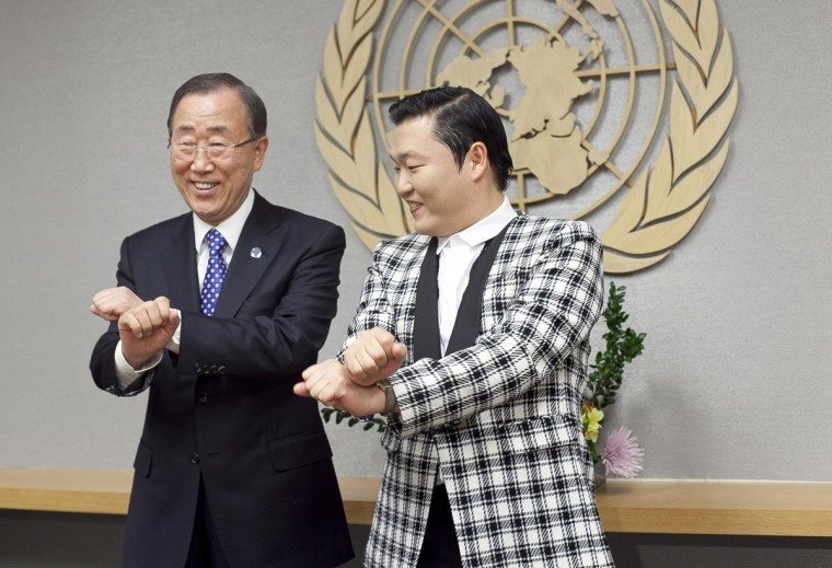 South Korean singer Psy (R), whose real name is Park Jae-sang, visits UN Secretary General Ban Ki-moon at the United Nations in New York City. (Allison Joyce/Getty Images)