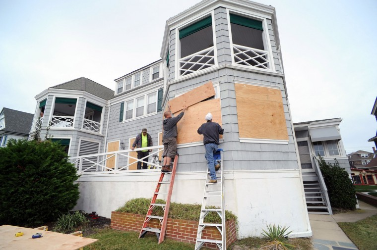 From left, Bob Grabenstetter, Paul Young and Mike Kern board up the Mae West Hotel in preparation for Hurricane Sandy in Cape May, New Jersey. New Jersey Governor Chris Christie has ordered mandatory evacuations of the barrier islands in New Jersey by 4 p.m. Sunday, including the Atlantic City casinos as Hurricane Sandy threatens the east coast. (William Thomas Cain/Getty Images)