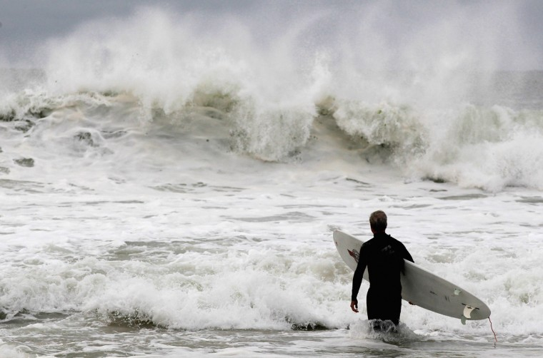 A man surfs as Hurrican Sandy approaches in Long Beach, New York. Sandy, which has already claimed over 50 lives in the Caribbean, is predicted to bring heavy winds and flooding to the mid-atlantic region. (Mike Stobe/Getty Images)