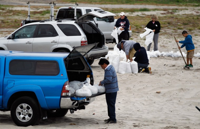 Residents of Long Beach fill sand bags as Hurricane Sandy approaches Long Beach, New York. ( Mike Stobe/Getty Images)