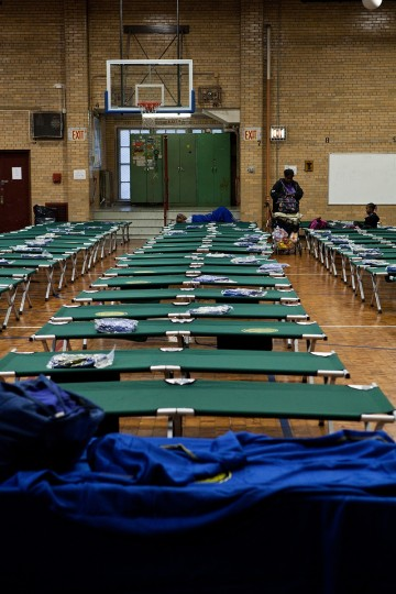 Cots are seen at Seward Park High School, which is doubling as an evacuation center, in preparation for Hurricane Sandy in New York City. Sandy, which has already claimed over 50 lives in the Caribbean, is predicted to bring heavy winds and floodwaters as the mid-atlantic region prepares for the damage. ( Andrew Burton/Getty Images)