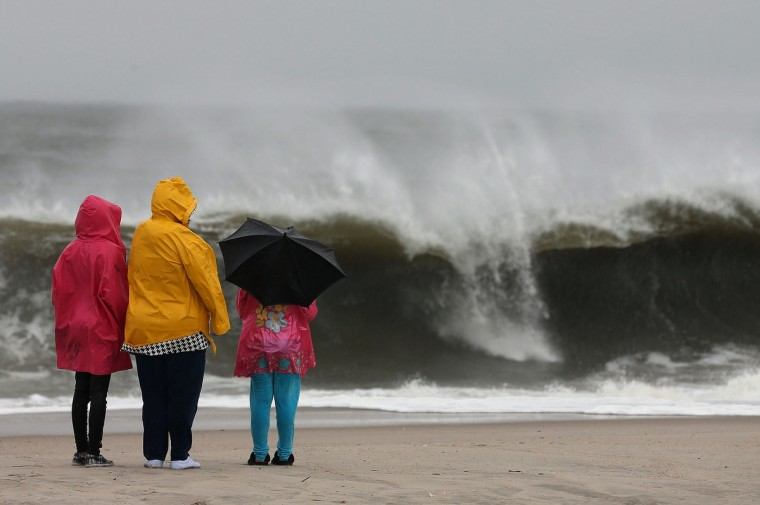 People stand on the beach watching the heavy surf caused by the approaching Hurricane Sandy in Cape May, New Jersey. Hurricane Sandy is expected to hit the New Jersey coastline sometime on Monday bringing heavy winds and floodwaters. (Mark Wilson/Getty Images)