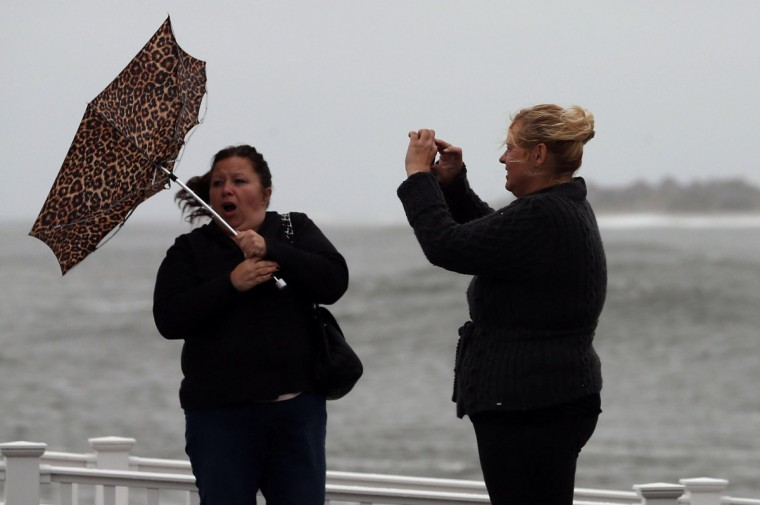 Lisa Cellucci (L), holds her umbrella as it is blown backwards from Hurricane Sandy's winds, as her friend Kim Vo (R) watches in Cape May, New Jersey. Hurricane Sandy is expected to hit the New Jersey coastline sometime on Monday bringing heavy winds and floodwaters. (Mark Wilson/Getty Images)