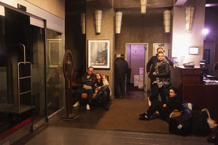 People wait in the lobby of the Hampton Inn Manhattan-SoHo after the power went out in New York City. A large part of Manhattan below 26th St. has lost power reportedly because of flooding. (Preston Rescigno/Getty Images)