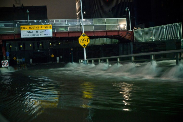 Water rushes into the Carey Tunnel (previously the Brooklyn Battery Tunnel), caused by Hurricane Sandy in the Financial District of New York, United States. (Andrew Burton/Getty Images)
