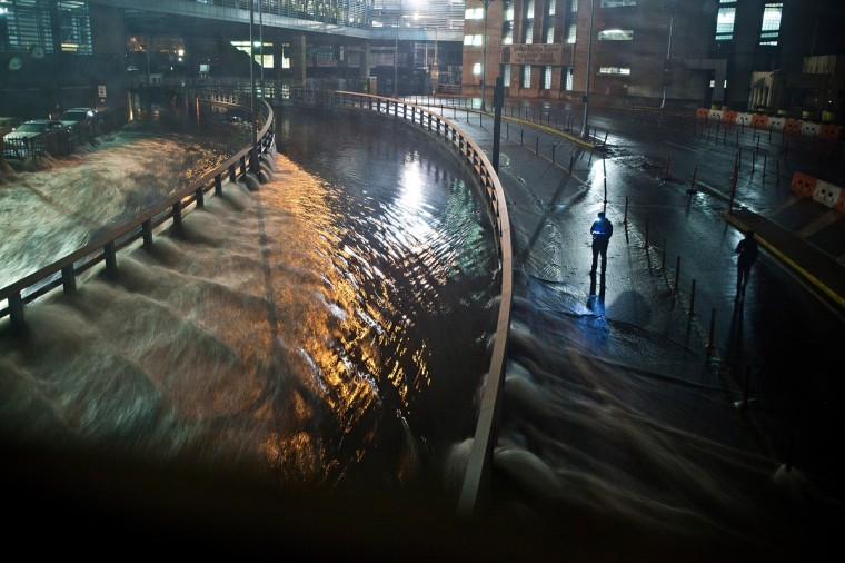 Water rushes into the Carey Tunnel (previously the Brooklyn Battery Tunnel), caused by Hurricane Sandy in the Financial District of New York. Hurricane Sandy, which threatens 50 million people in the eastern third of the U.S., is expected to bring days of rain, high winds and possibly heavy snow. New York Governor Andrew Cuomo announced the closure of all New York City will bus, subway and commuter rail service as of Sunday evening (Andrew Burton/Getty Images)