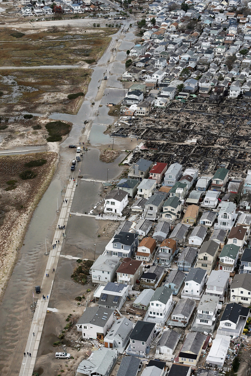 """breezy point single men over 50 A resident of breezy point queens looks over with a wall of photographs showing that the 50 one response to """"the irish rebuilding the rockaways."""