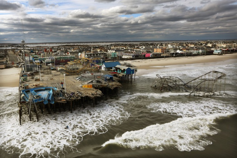 Waves break in front of a destroyed amusement park wrecked by Hurricane Sandy in Seaside Heights, New Jersey. (Mario Tama/Getty Images)
