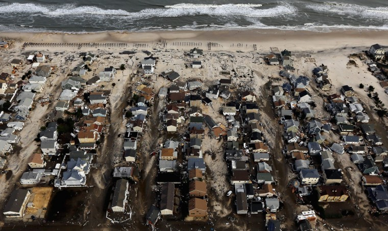 Homes are surrounded by sand washed in by Hurricane Sandy on in Seaside Heights, New Jersey. (Mario Tama/Getty Images)