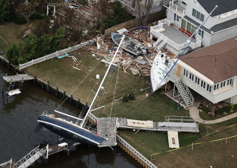 Boats are strewn among houses amid wreckage from Superstorm Sandy in Sea Bright, New Jersey. (Mario Tama/Getty Images)