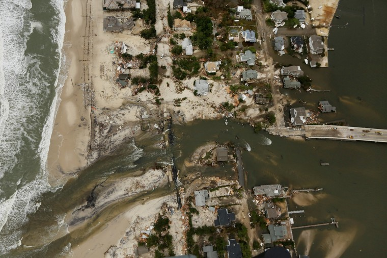 Homes sit in ruin at the end of a bridge wrecked by flooding from Superstorm Sandy in Mantoloking, New Jersey. (Mario Tama/Getty Images)