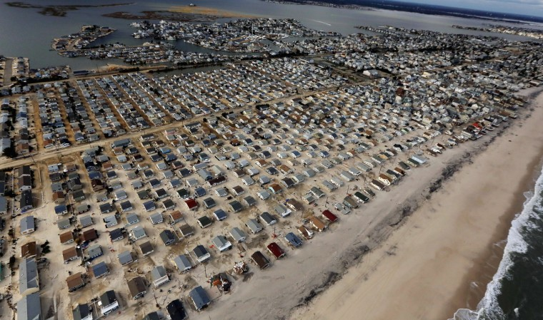Homes in the Dover Beaches North neighborhood are surrounded by sand washed in by Superstorm Sandy in Ocean County, New Jersey. (Mario Tama/Getty Images)