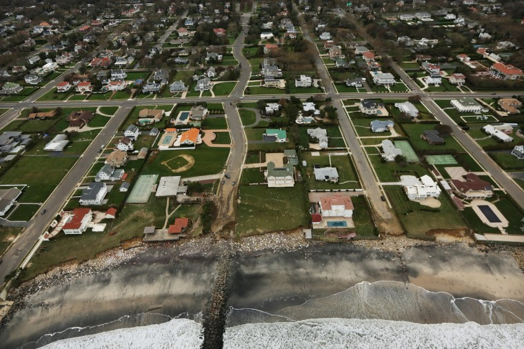 Rubble from Superstorm Sandy remains by homes at the edge of the Atlantic Ocean in Long Branch, New Jersey. (Mario Tama/Getty Images)