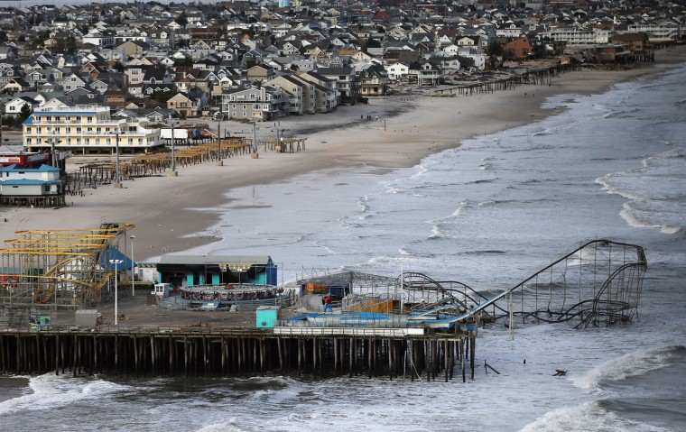 Waves break in front of a destroyed amusement park wrecked by Superstorm Sandy in Seaside Heights, New Jersey. (Mario Tama/Getty Images)