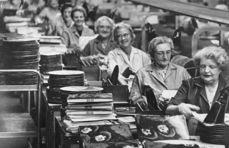 Workers on a production line in the EMI factory at Hayes, Middlesex, where the Beatles' new album 'Rubber Soul' is in the final stages of production. (Keystone/Getty Images)