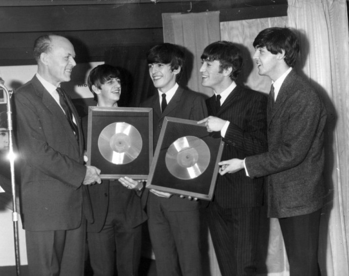 18th November 1963: Sir Joseph Lockwood, chairman of EMI, presents The Beatles with two silver discs, to mark the 1/4 million plus sales of their two long playing records , 'Please, Please Me' and 'With The Beatles'. (Keystone/Getty Images)