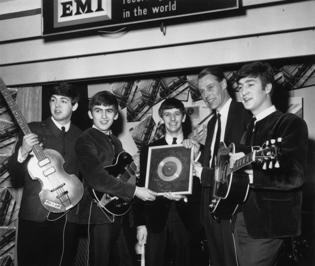 8th April 1963: British pop group The Beatles holding their silver disc. Left to right are, Paul McCartney, George Harrison (1943 - 2001), Ringo Starr, George Martin of EMI and John Lennon (1940 - 1980). (Chris Ware/Keystone/Getty Images)