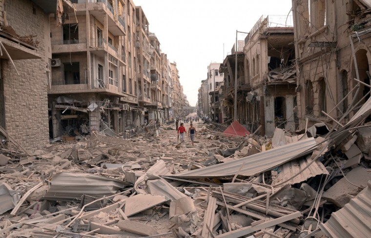 A handout picture released by the Syrian Arab News Agency (SANA) shows what the official agency described as the scene of car bomb explosions that hit the northern Syrian city of Aleppo. Three car bombs tore through the heart of Syria's commercial capital in the morning, killing at least 27 people and wounding 72 others. (SANA/GettyImages)