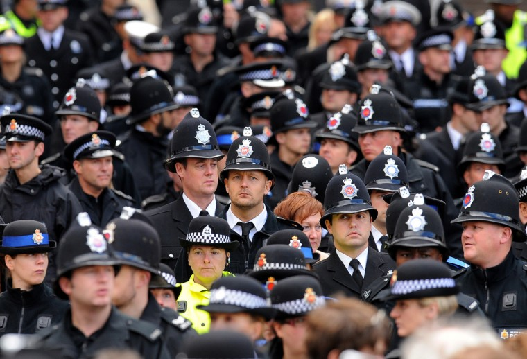 British police personnel attend the funeral of murdered police colleague Nicola Hughes at Manchester Cathedral in Manchester, north-west England. PC Nicola Hughes, 23, and PC Fiona Bone, 32, were killed in a gun and grenade attack as they responded to what they thought was a routine burglary call in Tameside, Greater Manchester, northwestern England, on September 18, 2012. (Andrew Yates/GettyImages)