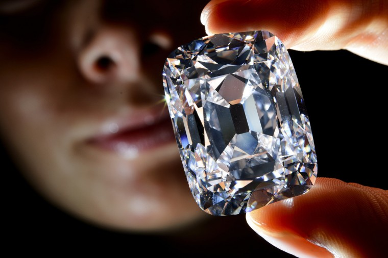 """A model holds the """"Archduke Joseph"""" historical diamond during a Christie's auction preview in Geneva. Once part of the collection of the Archduke Joseph of Austria (1872-1962), the D color diamond, weighing 76,02 carats and mined at the legendary Indian Golkonda mine, is expected to reach between 15 million and 20 million US dollars at an auction on November 13 in Geneva. (Fabrice Coffrini/GettyImages)"""