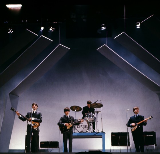 The Beatles Paul McCartney (l), George Harrison (2-L), Ringo Starr (2-R) and John Lennon (R) perform on stage during a concert on July 29,1965, in London. (GettyImages)