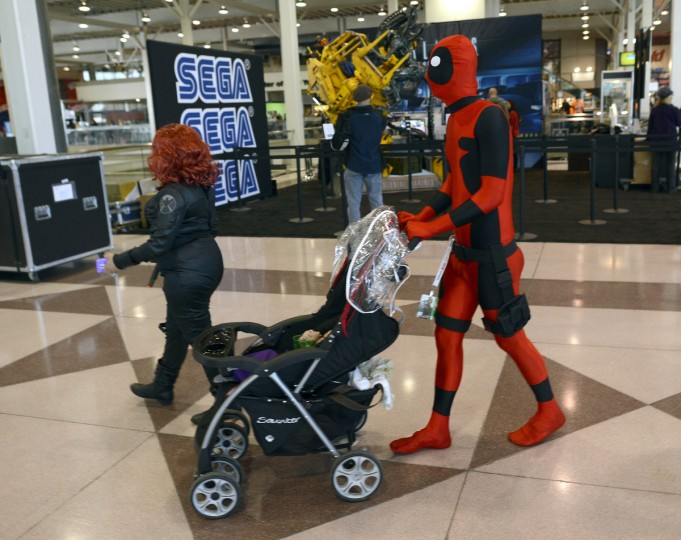 Michael Bishop pushes his son Thomas, 2 months, as they wait for the opening of the 2012 New York Comic Con. (Timothy Clary/Getty Images)