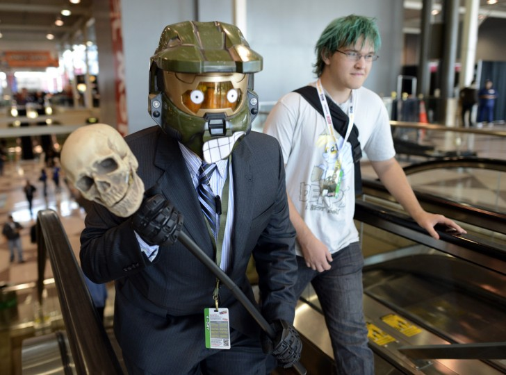 A man dressed in costume as fans arrive for the opening session of the 2012 New York Comic Con. (Timothy Clary/Getty Images)