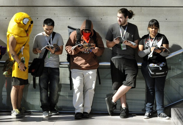Fans arrive for the opening session of the 2012 New York Comic Con. (Timothy Clary/Getty Images)