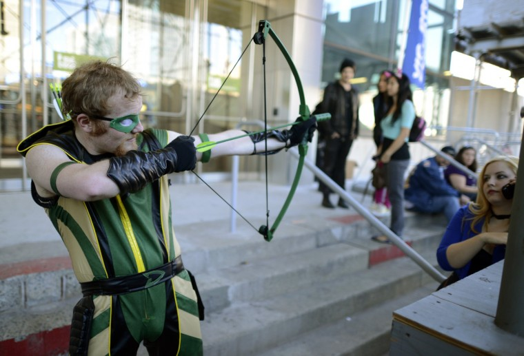 Scott Beaulie and other fans arrive for the opening session of the 2012 New York Comic Con. (Timothy Clary/Getty Images)