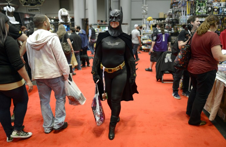 Fans in costume arrive for the opening session of the 2012 New York Comic Con. (Timothy Clary/Getty Images)