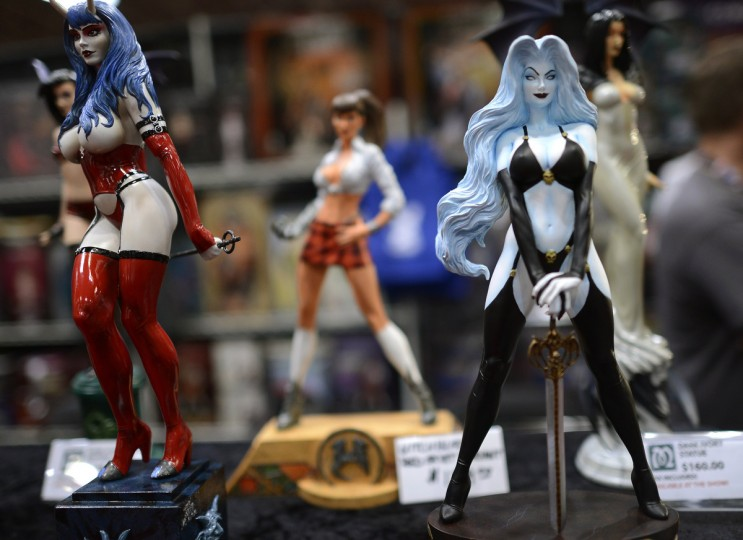 Sexy statues are on display at the 2012 New York Comic Con. (Timothy Clary/Getty Images)