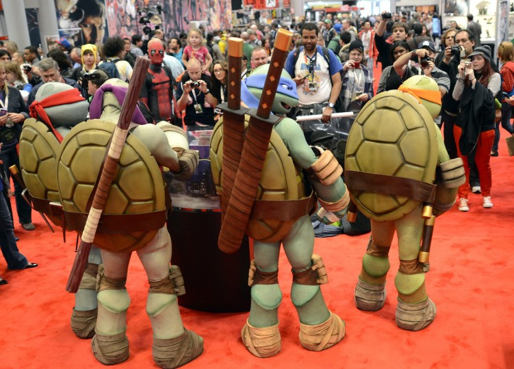 Mutant Ninja Turtles pose for photos as fans in costume arrive for the opening session of the 2012 New York Comic Con. (Timothy Clary/Getty Images)