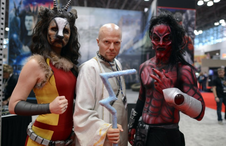 People from New Gen Universe in costume arrive for the opening session of the 2012 New York Comic Con at the Jacob Javits Center. (Timothy Clary/Getty Images)