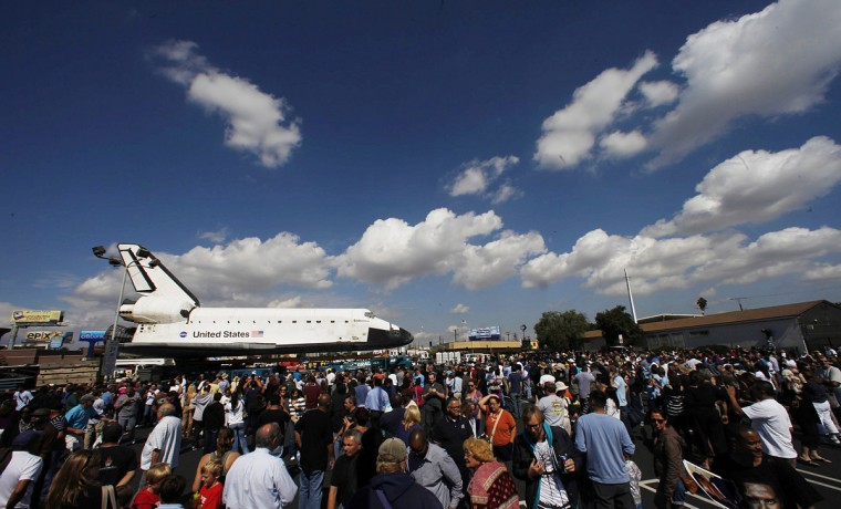 People crowd in front of the space shuttle Endeavour parked at a parking lot before it makes its way to a permanent home at the California Science Center. (Genaro Molina/GettyImages)