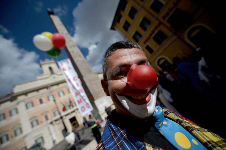 Circus workers protest in front of the Italian parliament in Rome's Piazza Montecitorio while the parliament is holding a session to talk of the animals used in circus. (Filippo Monteforte/Getty Images)