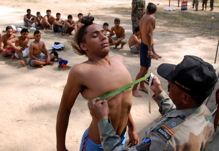 A potential Indian Army recruit has his chest measured during a physical fitness test at an Army recruitment rally at Kapurthala, around 20 km from Jalandhar. The Indian Army is a voluntary service and the world's largest standing volunteer army, with over a million active personnel and just under a million in reserve. (Sahmmi Mehra/Getty Images)