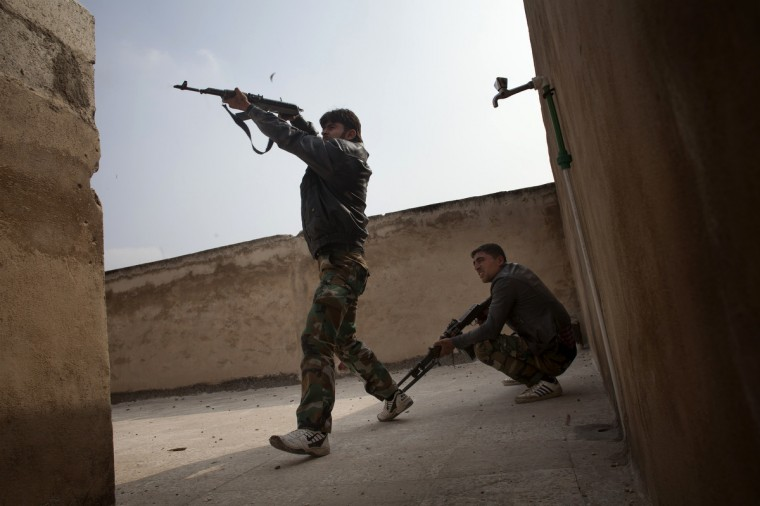 "Rebel fighters fire from the rooftop of house against Syrian government forces in the Bab el-Adid district in Aleppo. UN-Arab League envoy Lakhdar Brahimi is pushing ""extremely hard"" for a ceasefire in Syria and will brief the UN Security Council on Wednesday on his efforts, the UN spokesman said. (Favio Bucciarelli/Getty Images)"