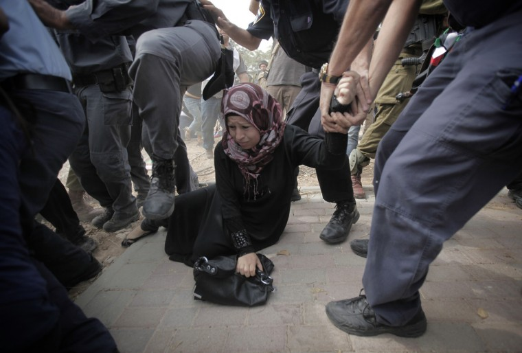 A Palestinian activist is arrested by Israeli soldiers as dozens of Palestinians block the entrance to branch of the Rami Levy supermarket opened in the Shaar Binyamin Jewish settlement close to the city of Ramallah in the Israeli occupied Palestinian West Bank as the protesters called for a boycott of goods being produced in the settlement. (Ahmad Gharabli/Getty Images)