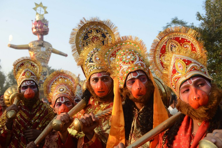 Indian Hindus dressed as deities Lord Hanuman pose during a religious procession on the grounds of Durgiana temple in Amritsar on the occasion of the Hindu festival of Dussehra. Held at the end of the Navratri (nine nights) Festival, Dussehra symbolizes the victory of good over evil in Hindu mythology. On the night of Dussehra, fire-crackers and stuffed effigies of Ravana are set alight in open grounds across the country. (Narinder Nanu/Getty Images)