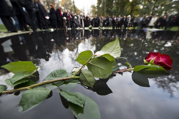 A flower lays on the memorial to the estimated half million Roma and Sinti murdered by the Nazis during World War II, in Berlin during an unveiling ceremony. Historians estimate nearly 500,000 Roma men, women and children across Europe were killed between 1933 and 1945, decimating a population with roots in Germany dating back six centuries. (John Macdougall/Getty Images)