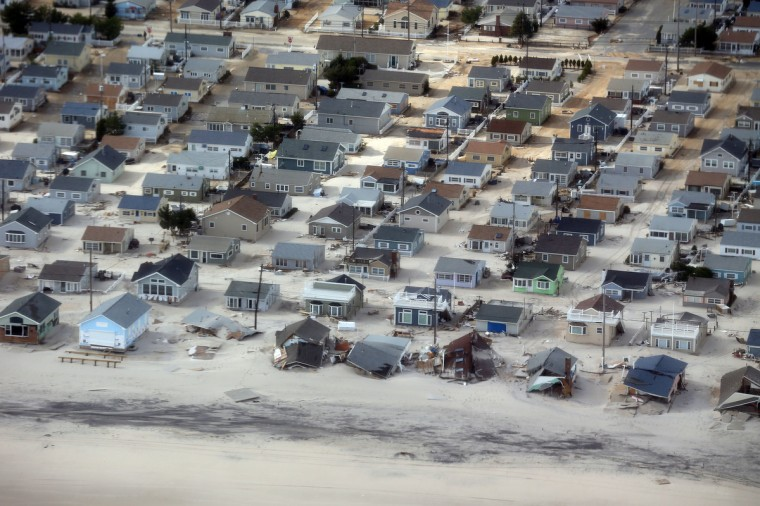 Homes in the Dover Beaches North neighborhood are surrounded by sand washed in by Superstorm Sandy in Ocean County, New Jersey. (Doug Mills/Getty Images)