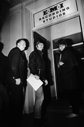 Ringo Starr and George Harrison of the Beatles arrive at the EMI recording studios on Abbey Road, 24th November 1966. (Larry Ellis/Express/Hulton Archive/Getty Images)