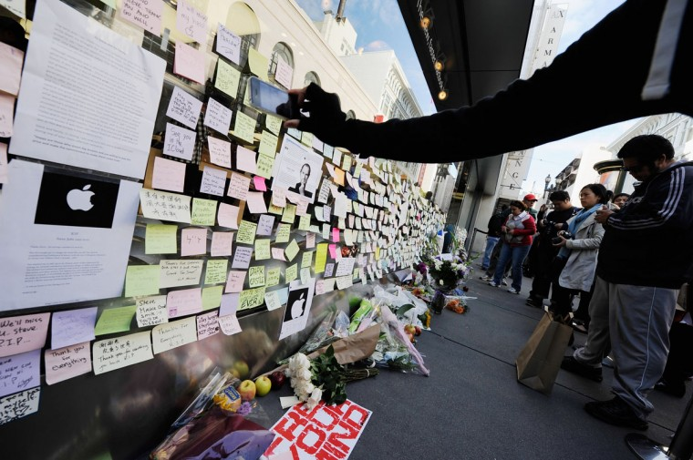 October 6, 2011: Fans leave condolence notes in memory of Steve Jobs at the Apple store in San Francisco, California. (Kevork Djansezian/Getty Images)