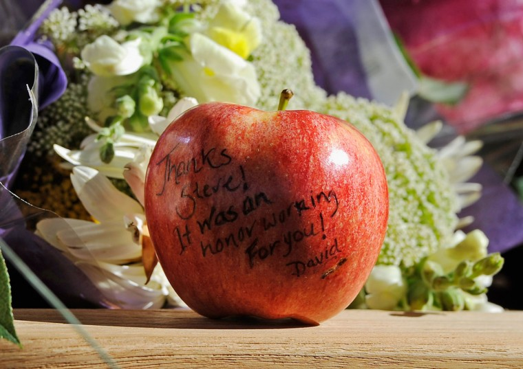 October 7, 2011: An apple with a message for Steve Jobs written on it sits at large makeshift memorial Jobs at the Apple headquarters on in Cupertino, California.(Kevork Djansezian/Getty Images)