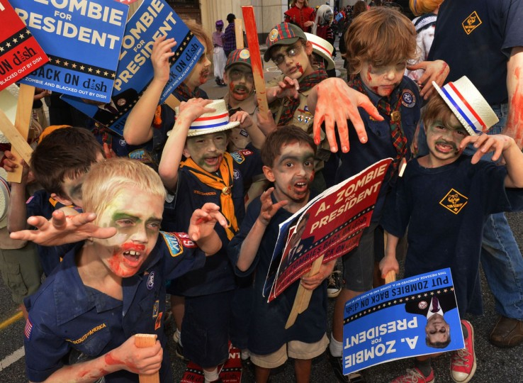 Cub Scout zombies pose before Presidential Candidate A. Zombie and his human wife Patty Morgan-Zombie walk in the Dragon*Con 2012 parade in Atlanta, Georgia. (Photo by Rick Diamond/Getty Images for AMC Networks)