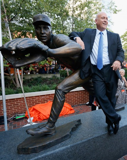 Hall of Fame player and former Baltimore Orioles Cal Ripken Jr stands next to his statue that was unveiled before the start of the Orioles and New York Yankees game at Oriole Park at Camden Yards on September 6, 2012 in Baltimore, Maryland. (Rob Carr/Getty Images)